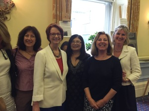 Former Australian PM Julia Gillard with members of the Lots Road Group of portrait artists