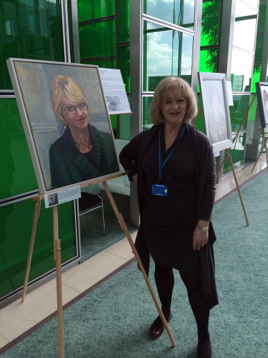 Sarah Reynolds at Barclays HQ with her portrait of Kay Ellen