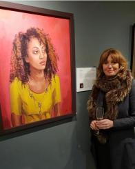 Colleen Quill with her portrait