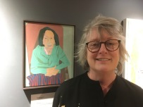 Maureen Nathan with her portrait.